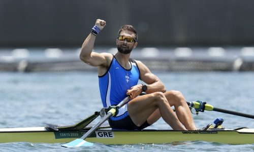 Stefanos Ntouskos of Greece reacts after competing in the men's rowing single sculls semifinal at the 2020 Summer Olympics, Thursday, July 29, 2021, in Tokyo, Japan. (AP Photo/Lee Jin-man)